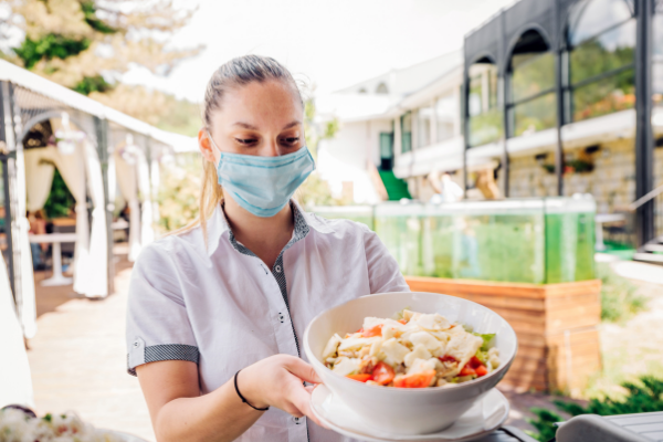 Waitress Serving Food During COVID