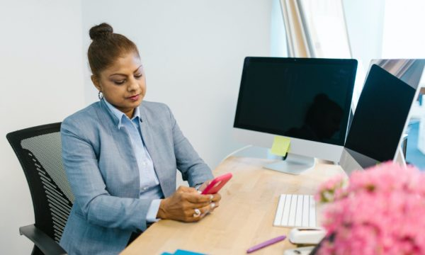 Woman working on phone in office
